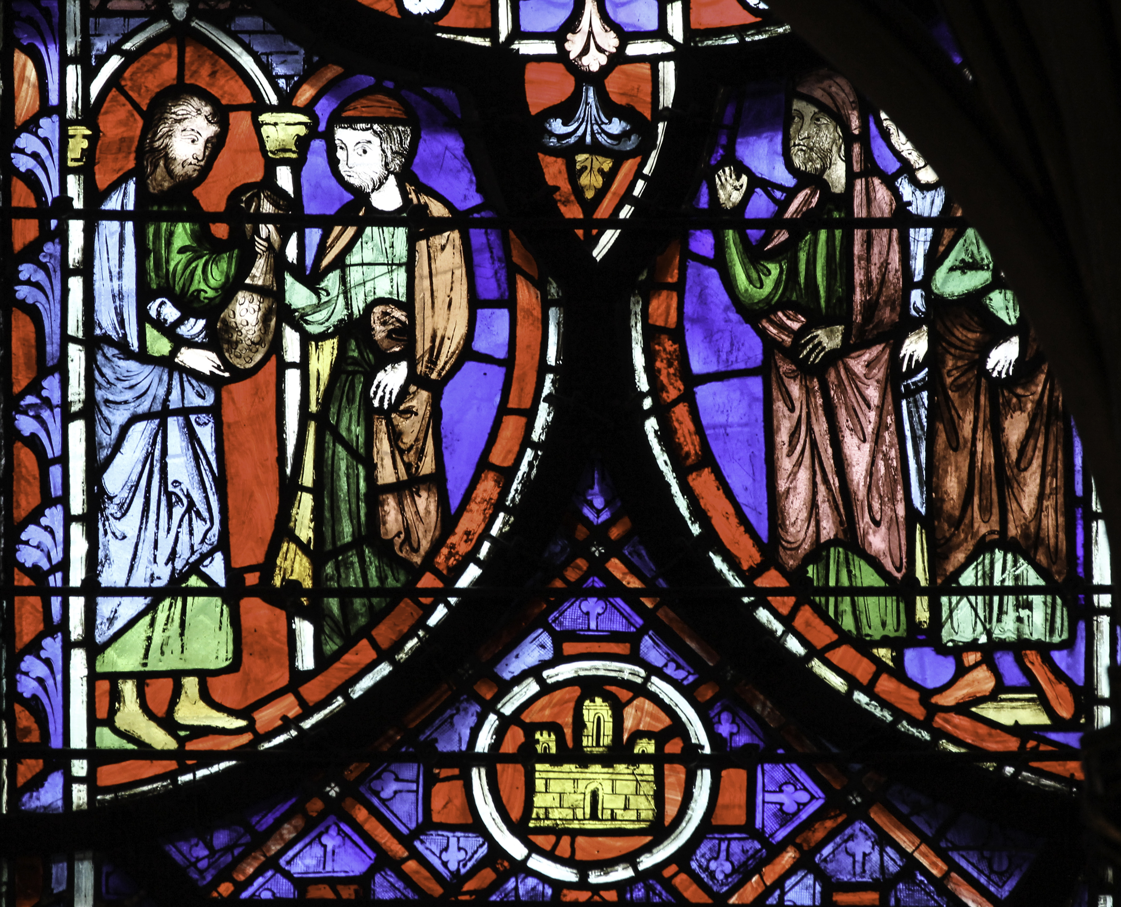 Stained glass detail from a window in the Sainte Chapelle, Paris, showing Judas handing over a bag of silver.