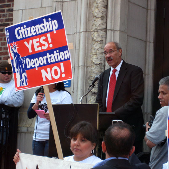 Sinkford speaking at an immigration rally; a sign in the foreground reads: 'Citizenship YES! Deportation NO!' Photo by Audra Friend/UUA.
