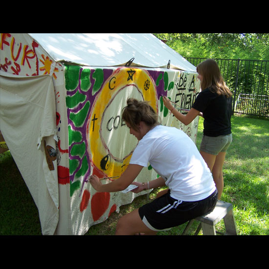 Youth of the First Unitarian Church of Dallas paint their 'Tent of Hope' for Darfur. Photo courtesy First Unitarian Church of Dallas.
