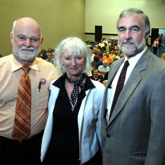 Charlie Clements, Sharon D. Welch, and William F. Schulz standing in front of the attendees for their workshop. Photo by Nancy Pierce.