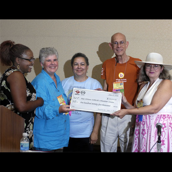 Representatives from the Unitarian Universalist Association and the Unitarian Universalsit Service Committee present a check for $125,000 to the New Orleans Rebirth Center. Photo by Nancy Pierce.