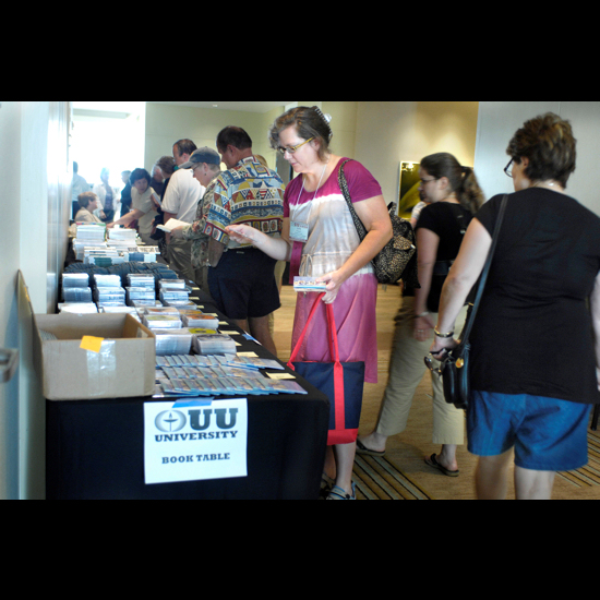People browse the UU University book table. Nancy Pierce.