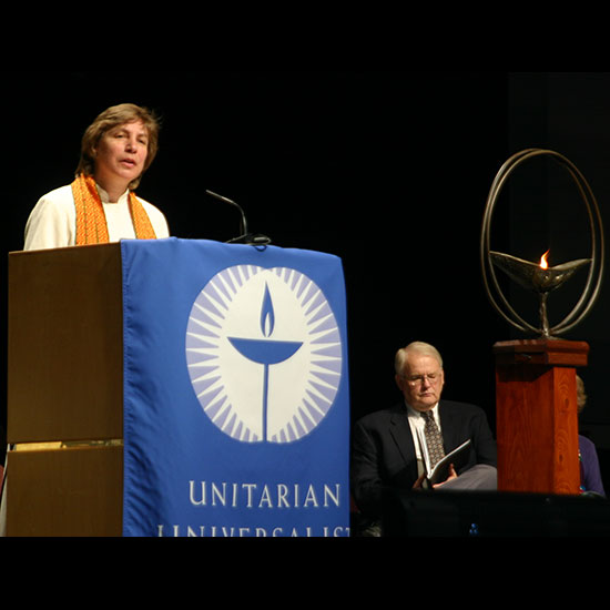 Rev. Alison M. Cornish, speaking from behind a podium. Photo by Rodney Lowe.