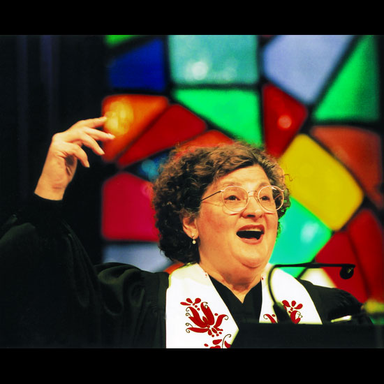 Barbara J. Pescan with her hand raised, preaching energetically. Photo by Nancy Pierce.
