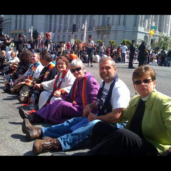 Unitarian Universalist Dennis Paul seated in a line of clergy during civil disobedience for marriage equality. Photo by Adams Blons.
