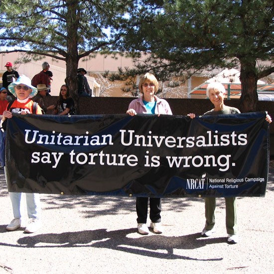 Unitarian Universalists in Albuquerque, NM, hold a banner that reads, 'Unitarian Universalists say torture is wrong. NRCAT (National Religious Campagin Against Torture).' Photo courtesy NRCAT.