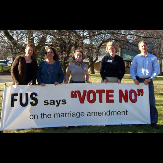 Wisconsin UUs holding a banner: 'FUS says VOTE NO on the marriage amendment.' Photo used with permission.