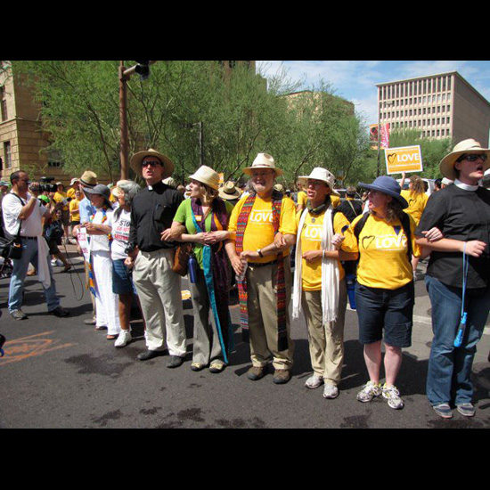 UUA President Rev. Peter Morales stands with others, arms linked, in the streets of Arizona to Stand on the Side of Love. Photo by UUA/Dea Brayden.