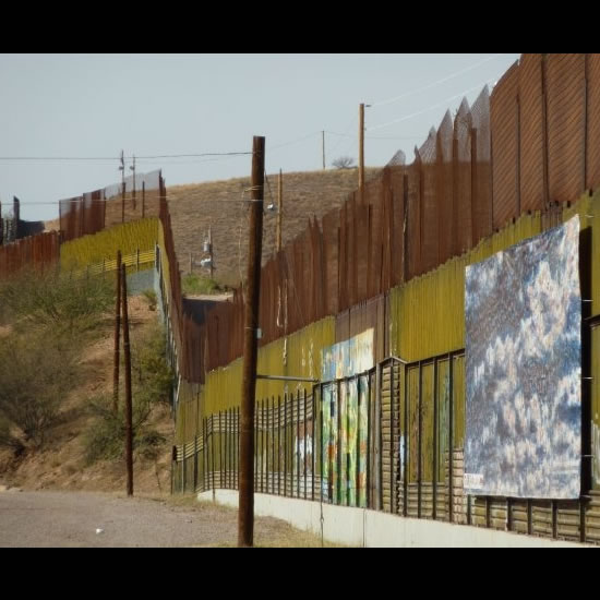 The Border Wall in Nogales, Mexico, stretching on for miles. Photo by Kat Liu.