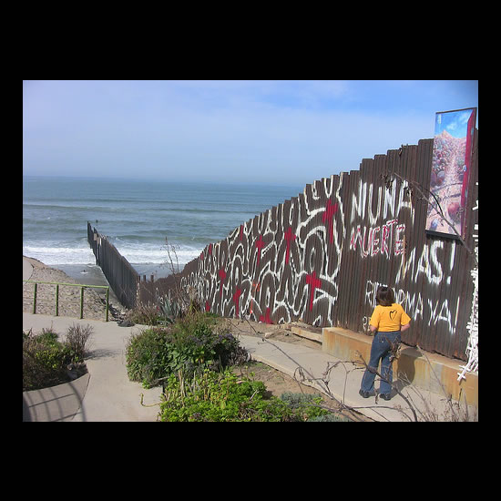 The Border Wall in Tijuana, running out into the Pacific. Photo by Adam Gerhardstein.