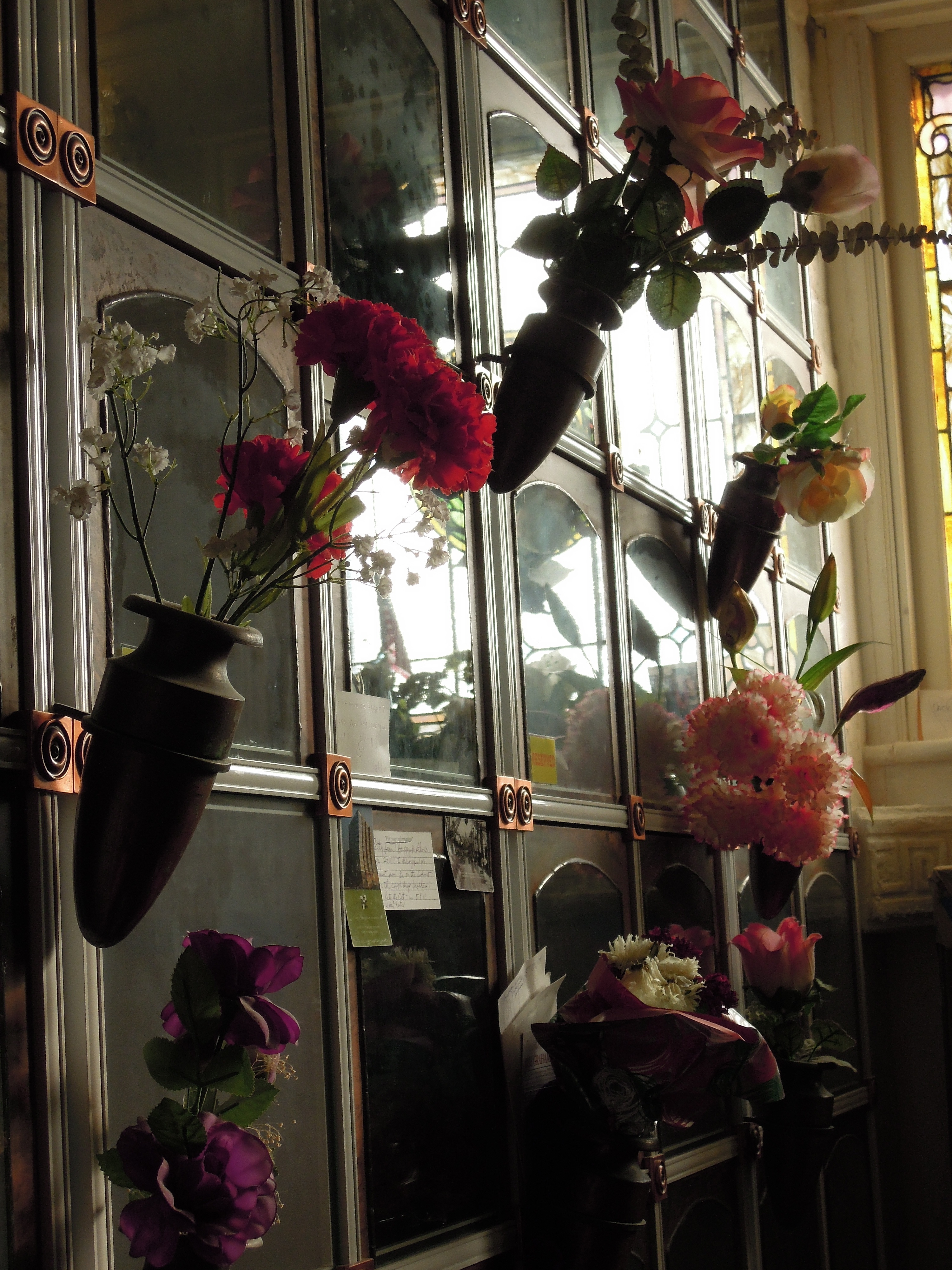 flowers and panes of a wall at the San Francisco columbarium (a repository for cremains)