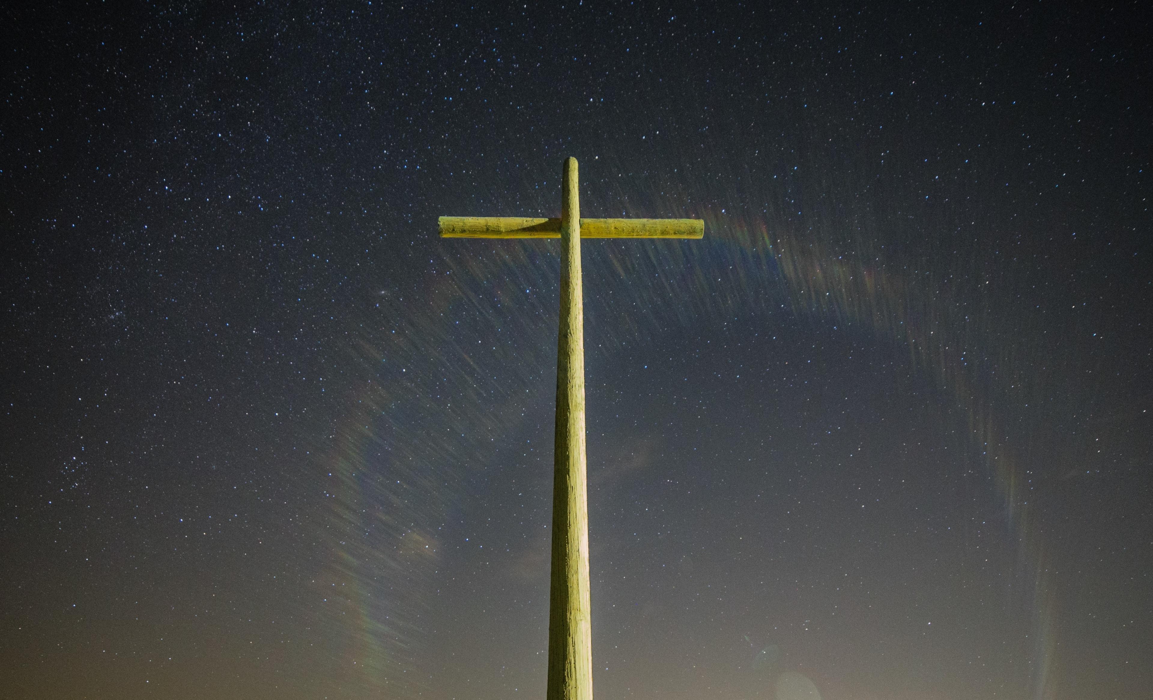 A stark cross against a starry night sky