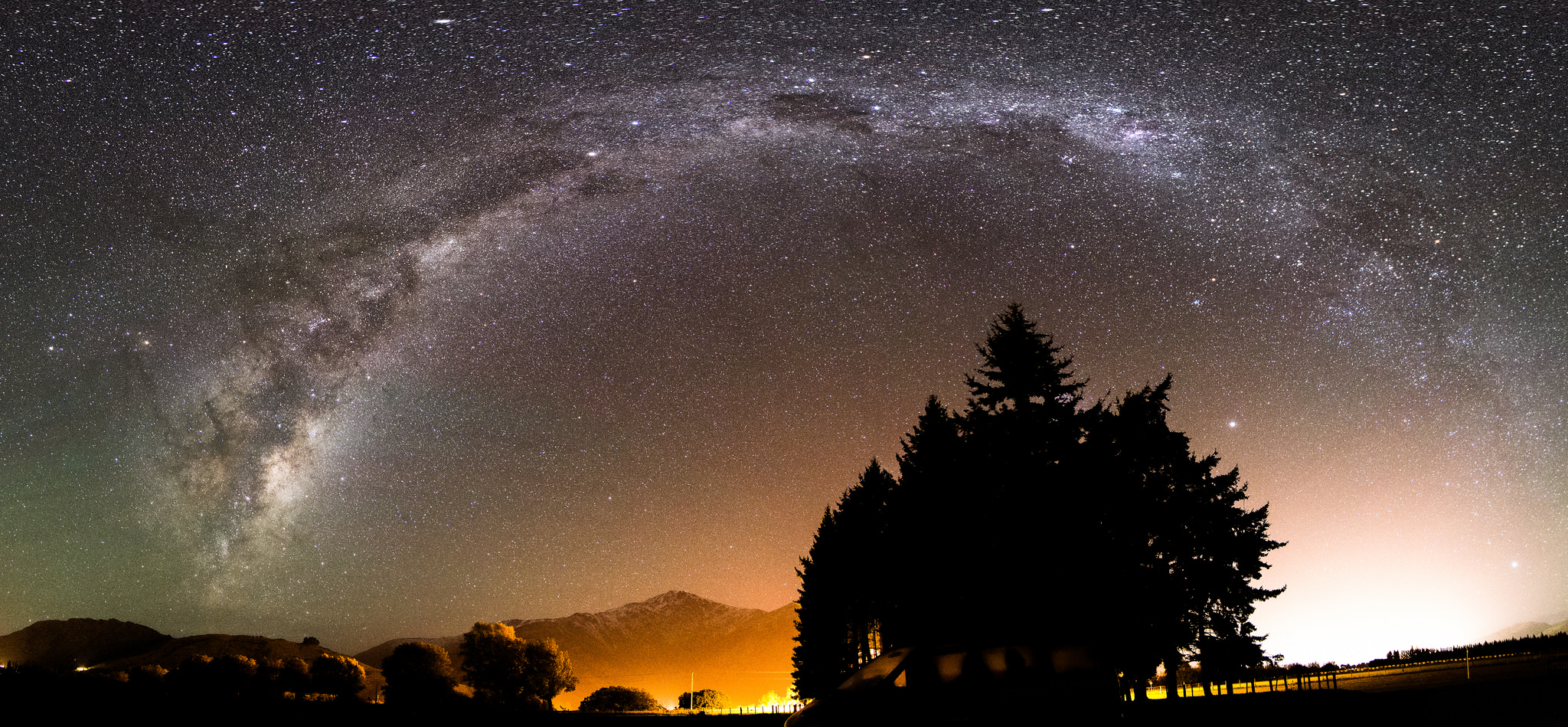A night sky with a band of stars