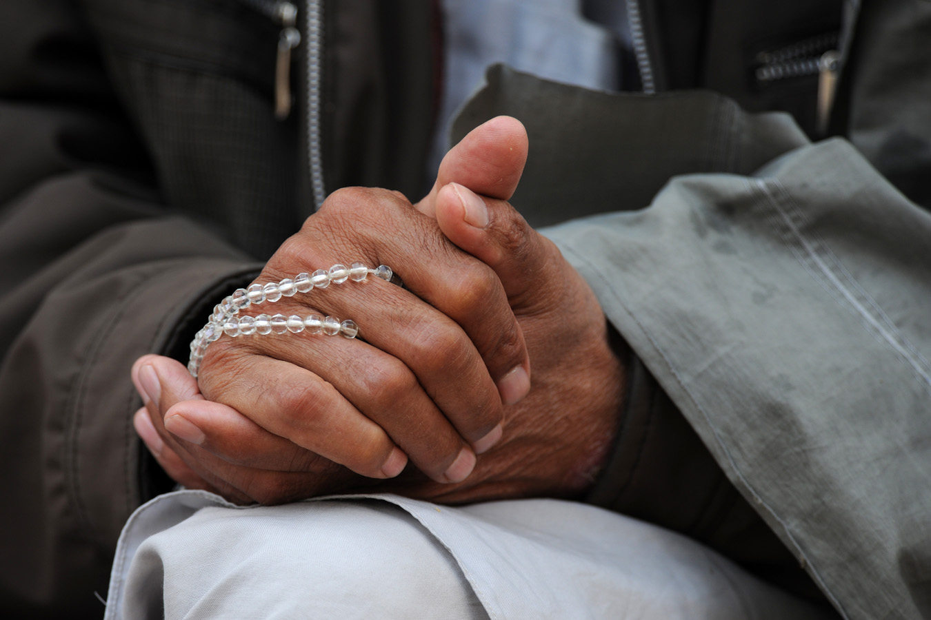 Abdul Satar Rahimi, the Deputy Director for the Farah Provincial Council, holds his prayer beads during a ribbon cutting ceremony March 8, 2010, Farah, Afghanistan.