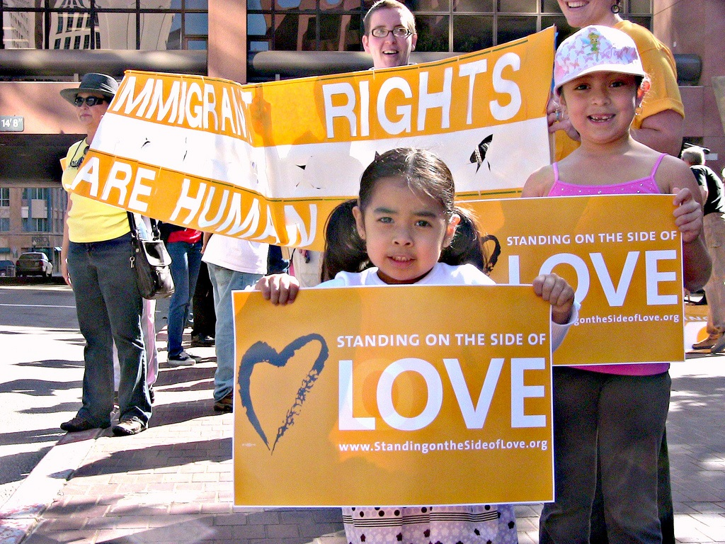 Standing on the Side of Love for immigrant rights at a 2010 rally in San Diego.