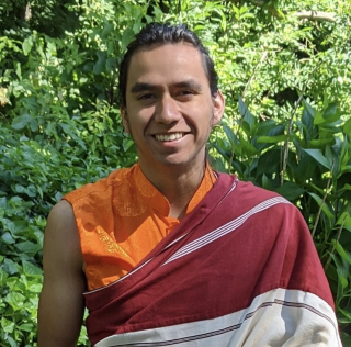 Photo of Tenzin Damchoe smiling at the camera