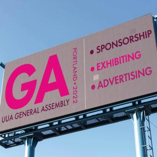 "An advertising billboard with the words ""2021 UUA General Assembly, Sponsorship, Exhibiting, Advertising"""