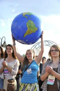 Girl holds up plastic earth ball at Environment Rally in March, 2014.