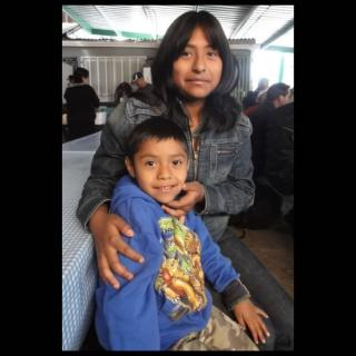 Mother and son at Mexican-American border.