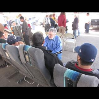 Rev. Peter Morales speaks with people at the Mexican-American border.