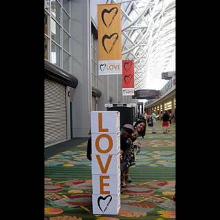 Hiding behind the LOVE blocks outside the Exhibit Hall.