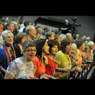 Crowd shot: people singing at the 2010 General Assembly Opening and Plenary I.