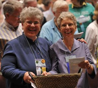 The newly called minister of the Church of the Larger Fellowship, the Rev. Meg Riley, and the recently retired minister, the Rev. Dr. Jane Rzepka. 2010 General Assembly CLF Worship.