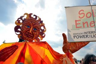 Sun puppet at the 2013 General Assembly Public Witness event for clean energy.