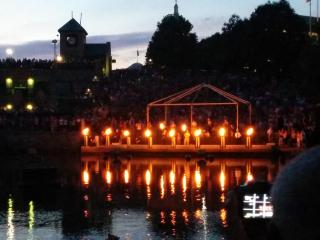 WaterFire is a downtown Providence riverfront community arts festival whose signature feature is braziers lit on the river.