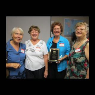 Members of UUs Clearwater, FL pose with their 2013 Bennett Award for Congregational Action on Human Justice and Social Action.