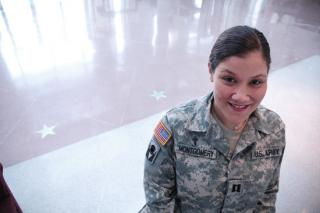 The Rev. Rebekah Montgomery, in her U.S. Army uniform, smiling for a formal picture.