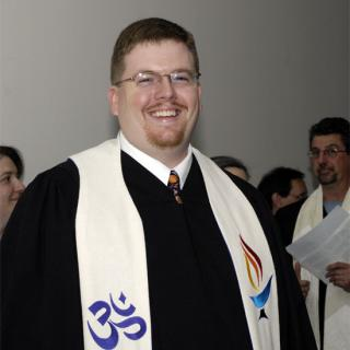 Jason Shelton, grinning in his ministerial garb.