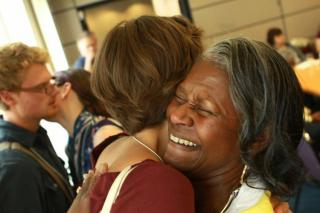Two women hugging at General Assembly.