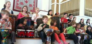 A youth choir, drumming.