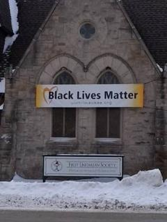 Black Lives Matter sign above entrance to First Unitarian Society of Milwaukee.
