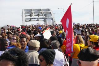 A crowd including many Unitarian Universalists crosses the Edmund Pettus Bridge in Selma, Alabama in March 2015.