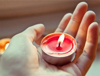 Candle in a person's hand