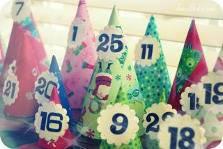 Small cones, covered in wrapping paper, each bears a number to count down December's days