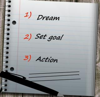 Notebook with words dream, set goal, action