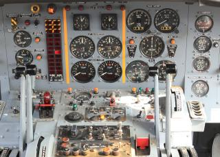 Airplane cockpit with analog dials