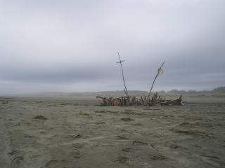 "On a desolate beach, driftwood forms a ghostly ""boat"""