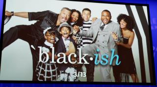 "The cast of the TV show ""Black-ish"" on a screen."