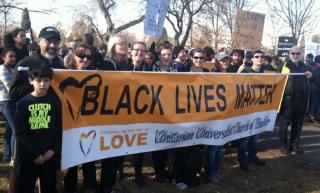 UUs holding Black Lives Matter banner witness for racial justice in Denver, CO, January 2015.