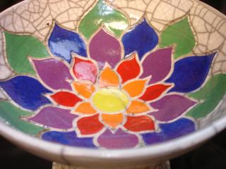 Bowl of a chalice with a rainbow lotus design