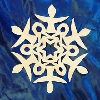 "A paper snowflake with 6 ""arms"" that resemble flaming chalices"