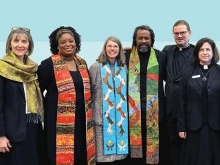 Six UU ministers stand together.