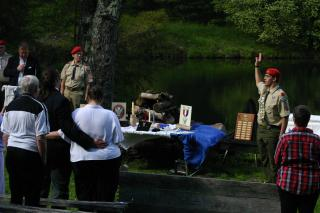 An Eagle Scout, hand raised in salute, reciting the Eagle Scout Oath