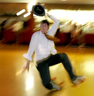 A blurry photograph of a roller skater in mid-fall