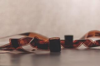 An unrolled roll of exposed film