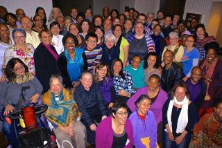 Unitarian Universalist religious professionals of many races and ethnicities pose for a group shot.
